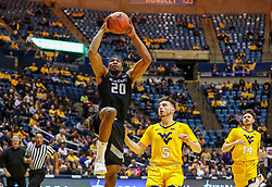 Feb 18, 2019; Morgantown, WV, USA; Kansas State Wildcats forward Xavier Sneed (20) shoots during the first half against the West Virginia Mountaineers at WVU Coliseum. Mandatory Credit: Ben Queen-USA TODAY Sports