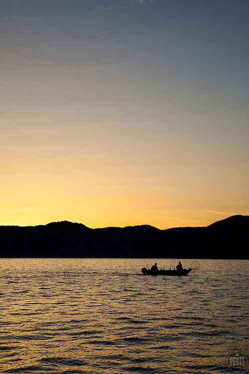 """""""Sunrise Fishing on Lake Tahoe 5"""" - Photograph of a small boat fishing on Lake Tahoe at sunrise during the 2012 Jake's on the Lake fishing derby."""