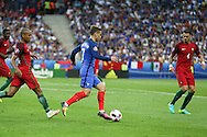 France Forward Antoine Griezmann takes on the Portugal defence during the Euro 2016 final between Portugal and France at Stade de France, Saint-Denis, Paris, France on 10 July 2016. Photo by Phil Duncan.