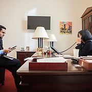 Representative Pramila Jayapal (D-WA, 7) does a phone interview with KOMO Radio, a local Seattle radio station, as Communications Director, Omer Farooque takes notes, on Tuesday, January 31, 2017.  For The Stranger (Seattle, WA).