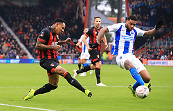 Bournemouth's Nathaniel Clyne (left) and Brighton & Hove Albion's Jurgen Locadia battle for the ball during the Emirates FA Cup, third round match at the Vitality Stadium, Bournemouth.