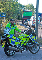 © Licensed to London News Pictures 29/09/2021.<br /> Swanley, UK, Police stand guard at junction three of the M25 in Kent as Insulate Britain protesters are arrested again. Photo credit:Grant Falvey/LNP