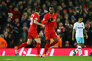 Divock Origi of Liverpool (c) celebrates with his teammates after scoring his teams 2nd goal. Premier League match, Liverpool v West Ham Utd at the Anfield stadium in Liverpool, Merseyside on Sunday 11th December 2016.<br /> pic by Chris Stading, Andrew Orchard sports photography.
