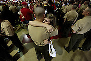 Cindy Smith hold on to her boyfriend Josh Cook for the first time in twelve weeks as he is released to his family during a ceremony the day before he graduates and becomes a marine.  Marine Corps Recruit Depot at Parris Island in South Carolina is where all male recruits living east of the Mississippi River and all female recruits from all over the US receive their arduous twelve week training in their quest to become marines. Even though there are two current active wars and a weak economy, recruitment has not been effected.  Actually, recruiting numbers have increased, with more young men and women looking toward the military for answers.