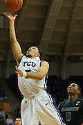 FORT WORTH, TX - JANUARY 7: Kyan Anderson #5 of the TCU Horned Frogs drives to the basket against the Kansas State Wildcats on January 7, 2014 at Daniel-Meyer Coliseum in Fort Worth, Texas.  (Photo by Cooper Neill/Getty Images) *** Local Caption *** Kyan Anderson