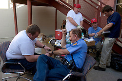 08 Sept 2005. New Orleans, Louisiana. Hurricane Katrina aftermath. <br /> Officer Frank Denton gets his hepatitis A and B and tetanus shots and health treatment from paramedics at a makeshift clinic at the 2nd precinct in uptown New Orleans.<br /> Photo; ©Charlie Varley/varleypix.com