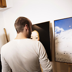 """SAINT-OUEN, FRANCE. SEPTEMBER 2, 2011. Photographer Remi Chapeaublanc showing his work for """"Les Expos a la Maison"""" (Home Exhibitions) is a one-night exhibit organized at a private individual's home by an organization called """"From Paris"""". Photo: Antoine Doyen"""
