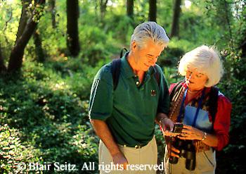 Active Aging Senior Citizens, Retired, Activities, Elderly Couple Outdoor Recreation, Staying Fit, Enjoying Nature Elderly Couple Birdwatching in Woods, Birding