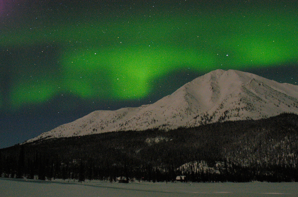 Alaska. Denali National Park. Aurora borealis (northern lights) over the park entrance sign to Denali National Park.