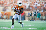 AUSTIN, TX - SEPTEMBER 26:  Jerrod Heard #13 of the Texas Longhorns scrambles against the Oklahoma State Cowboys during the 2nd quarter on September 26, 2015 at Darrell K Royal-Texas Memorial Stadium in Austin, Texas.  (Photo by Cooper Neill/Getty Images) *** Local Caption *** Jerrod Heard