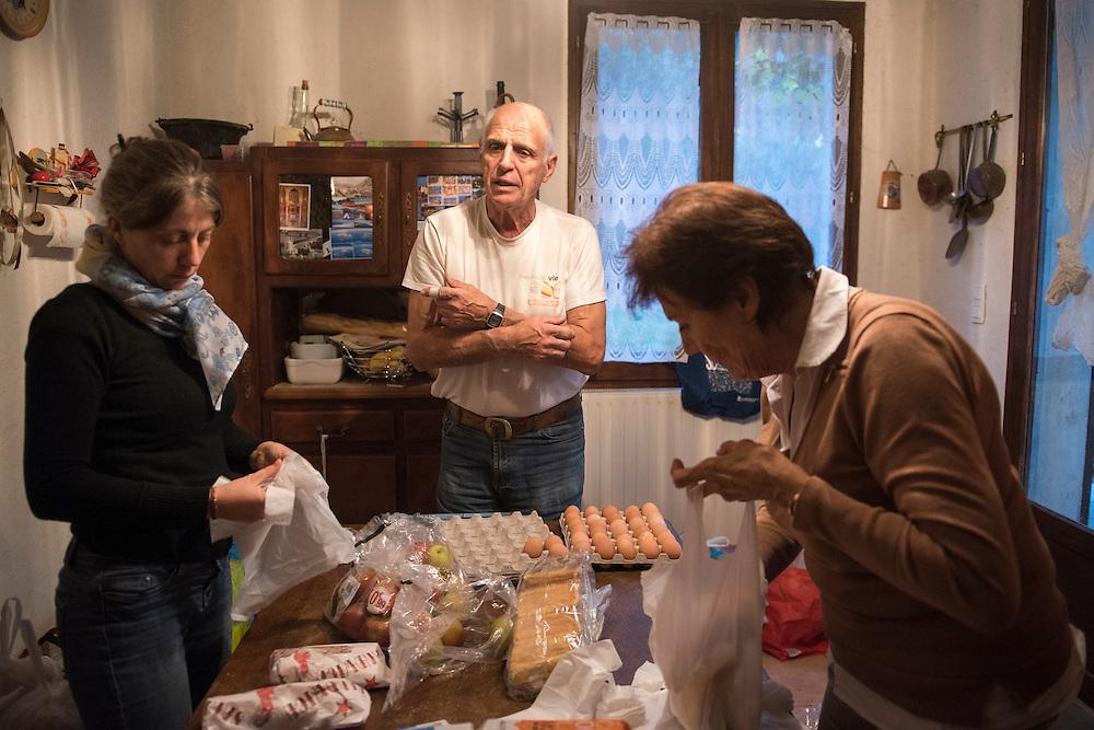 November 8, 2016 - Breil-sur-Roya, France: Jean-Pierre, a 70-year-old retired police officer his wife Giselle (71) and a volunteer prepare meals to distribute to migrants in Ventimiglia, Italy. Jean-Pierre and his wife Gisele, members of a network that helps migrants, distribute 120 meals weekly.<br /> <br /> 8 novembre 2016 - Breil-sur-Roya, France: Jean-Pierre, 70 ans, policier retraité, sa femme Giselle (71 ans) et un volontaire préparent des repas pour les distribuer aux migrants à Vintimille en Italie. Jean-Pierre et Gisele sont membres d'un réseau d'aide aux migrants, et distribuent 120 repas par semaine.