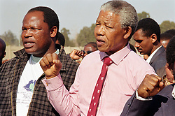 NELSON ROLIHLAHLA MANDELA (July 18, 1918 - December 5, 2013), 95, world renown civil rights activist and world leader. Mandela emerged from prison to become the first black President of South Africa in 1994. As a symbol of peacemaking, he won the 1993 Nobel Peace Prize. Joined his countries anti-apartheid movement in his 20s and then the ANC (African National Congress) in 1942. For next 20 years, he directed a campaign of peaceful, non-violent defiance against the South African government and its racist policies and for his efforts was incarcerated for 27 years. Remained strong and faithful to his cause, thru out his life, of a world of peace. Transforming the world, to make it a better place. PICTURED:  June 21,1992 - Boipatong, Vaal, Transvaal, South Africa - ANC President NELSON MANDELA. (Credit Image: © Greg Marinovich/ZUMA Wire/ZUMAPRESS.com)