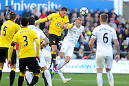 Watford's Jose Holebas (c) heads clear from Swansea's Alfie Mawson. Premier league match, Swansea city v Watford at the Liberty Stadium in Swansea, South Wales on Saturday 22nd October 2016.<br /> pic by  Carl Robertson, Andrew Orchard sports photography.