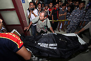 MEDAN, INDONESIA - JUNE 30: <br /> <br /> Victims of Indonesian Military Plane Crash<br /> <br /> Indonesia military lift the bodies of Indonesia air force Hercules C-130 that crashed at Adam Malik hospital on June 30 in Medan, North Sumatra Province, Indonesia. An Indonesian air force Hercules C-130 plane with 12 crew aboard has crashed into a residential neighborhood in the country's third-largest city Medan. A hospital official said at least thirty people were killed.<br /> ©Ahmad Ridwan Nasution/Exclusivepix Media