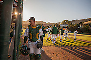 San Marin catcher Mitchell Ho returns to the dugout before the bottom of the 8th inning during the North Coast Section Division 3 championship game against Acalanes High's on June 6, 2011. The  umpires suspended the game after the 10 complete innings with the score 4-4. NCS officials later declared both teams Co-champions.