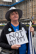 A lady holds a sign saying Not My PM as Brexit campaigners gather outside Houses of Parliament on the first day after summer recess on 3rd September 2019 in London in the United Kingdom.