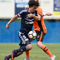 BRISBANE, AUSTRALIA - NOVEMBER 12: Pierce Waring of the Victory is tackled by Kye Rowles of the Roar during the round 1 Foxtel National Youth League match between the Brisbane Roar and Melbourne Victory at Spencer Park on November 12, 2016 in Brisbane, Australia. (Photo by Patrick Kearney/Brisbane Roar)
