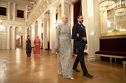Crown Princess Mette Marit of Norway and Crown Prince Haakon of Norway walk into dinner at the Royal Palace on day three of the royal visit by the Duke and Duchess of Cambridge to Scandinavia.