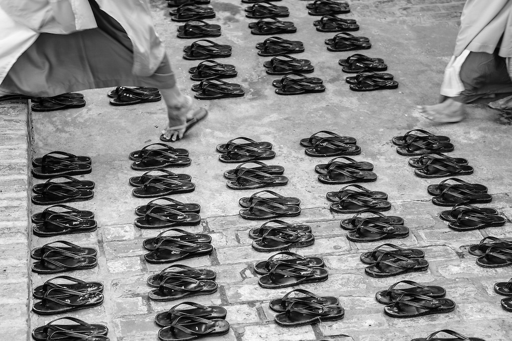 Buddhist nuns leave their shoes outside the lunch hall before their mid-day meal in Mandalay, Myanmar (Burma).
