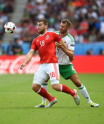 Sam Vokes of Wales battles for the ball with,  Gareth McAuley of Northern Ireland  - Mandatory by-line: Joe Meredith/JMP - 25/06/2016 - FOOTBALL - Parc des Princes - Paris, France - Wales v Northern Ireland - UEFA European Championship Round of 16