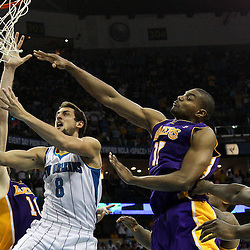 April 24, 2011; New Orleans, LA, USA; New Orleans Hornets shooting guard Marco Belinelli (8) shoots between Los Angeles Lakers center Andrew Bynum (17) and power forward Pau Gasol (16) during the fourth quarter in game four of the first round of the 2011 NBA playoffs at the New Orleans Arena. The Hornets defeated the Lakers 93-88.   Mandatory Credit: Derick E. Hingle