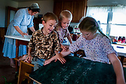 Old Order Mennonites do not have televisions or radios in their homes so the children often play board games or practice homework for entertainment. Old Order Mennonites are a branch of the Mennonite church. It is a term that is often used to refer to those groups of Mennonites who practice a lifestyle without some elements of modern technology.