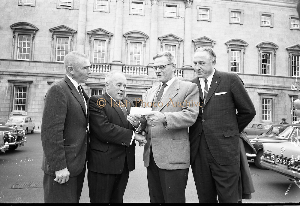 """21/07/1967<br /> 07/21/1967<br /> 21 July 1967<br /> Presentation for Fr. O'Flynn Memorial Park. The Irish American Heritage Society of Boston, USA, presented 400 dollars to Mr. A.A. Healy T.D., Chairman of the """"Loft"""" in Cork for the Fr O'Flynn Memorial Park at Passage West, Co. Cork at Leinster House, Dublin. Picture shows Mr. Harry Weldon, (2nd from right), (formerly Chief of the Vocational Schools in Cork and former member of the """"Loft"""") Founder-President of the Irish American Heritage Society of Boston presenting the cheque to Mr. A.A. (Gus) Healy T.D., with Mr. James McDonough, (left) and Mr. Joseph Patrick Murphy also of the Irish American Heritage Society."""