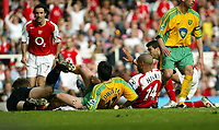 Photo. Chris Ratcliffe, Digitalsport<br /> Arsenal v Norwich City. Barclays Premiership. 02/04/2005<br /> Thierry Henry slots his third goal for arsenal