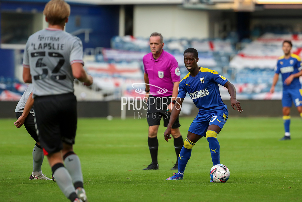 AFC Wimbledon defender Paul Osew (37) dribbling during the EFL Trophy Group O match between AFC Wimbledon and Charlton Athletic at the Kiyan Prince Foundation Stadium, London, England on 1 September 2020.