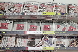 "© Licensed to London News Pictures. 13/03/2020. London, UK. Friday lunchtime shoppers buy British newspapers featuring the face of Prime Minister Boris Johnson and news of plummeting stock markets , with dire headlines such as "" Many Loved Ones Will Die "" and "" Many More Families Are Going to Lose Loved Ones "" , at a branch of Waitrose Supermarket in Finchley , North London . Retailers are struggling to replenish essentials , including toilet paper, pasta and hand sanitiser as panic buyers stock up in fear of quarantine measures as the current Coronavirus ( COVID-19 ) spread starts to impact more people . Photo credit: Joel Goodman/LNP"