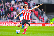 Max Power of Sunderland (27) takes a shot during the EFL Sky Bet League 1 first leg Play Off match between Sunderland and Portsmouth at the Stadium Of Light, Sunderland, England on 11 May 2019.