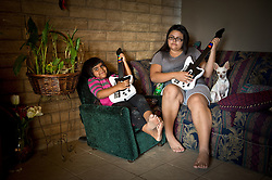 Left to right, sisters Ayasha, 4, and Ayona Hernandez, 13,play a game  on the Moapa reservation in Nevada. Because the air is so polluted, they can not spend much time outdoors. All of their family suffers from Asthma and though they can't prove it, believe its because of the coal plant next door. Her grandfather died in march because of cancer. The Sierra Club is working with the Moapa Band of Paiutes to transition NV Energy away from the Reid Gardner coal-fired power plant -- which sits only 45 miles from Las Vegas and a short walk from community housing at the Moapa River Indian Reservation. The Reid Gardner coal plant is literally spewing out tons of airborne pollutants such as mercury, nitrous oxide, sulfur dioxide, and greenhouse gases. This has resulted in substantial health impacts on the Moapa community, with a majority of tribal members reporting a sinus or respiratory ailment. Vernon Lee believes that the many people on the Moapa reservation suffering from health issues are because of the coal plant next door. Sierra Club is working with the Moapa Band of Paiutes to transition NV Energy away from the Reid Gardner coal-fired power plant -- which sits only 45 miles from Las Vegas and a short walk from community housing at the Moapa River Indian Reservation. The Reid Gardner coal plant is literally spewing out tons of airborne pollutants such as mercury, nitrous oxide, sulfur dioxide, and greenhouse gases. This has resulted in substantial health impacts on the Moapa community, with a majority of tribal members reporting a sinus or respiratory ailment.