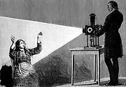 Jean Martin Charcot (1825-1903) French neurologist and pathologist, demonstrating production of hypnosis using beam of light from a magic lantern. Picture drawn from life at the Salpetriere Hospital, Paris. Freud heard of posthypnotic suggestion from Charcot. Engraving from 'La Nature', Paris, 1879.