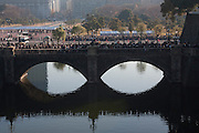 "Police control well-wishers as they  cross the ""Spectacles Bridge""  a double arch bridge to enter the Imperial Palace. Emperor Akihito 76th birthday was celebrated in Japan with a national holiday and thousands of well-wishers being allowed into the Royal Palace for the occasion. He made three appearances during the day and spoke of the economy difficulties many Japanese people are suffering during his address. He was accompanied by Empress Michiko, Crown Prince Naruhito, Prince Akishino and their wives. Tokyo, Japan December 23rd 2009"