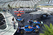 """Hangar-7; the spectacular home of the Flying Bulls (""""Red Bull"""" owner Didi Mateschitz' collection of classic airplanes) next to Salzburg W.A. Mozart airport. Red Bull Sauber Petronas Formula One and Indy racing cars, North American B-25J Mitchell twin-engine aircraft, Pitts S2B aerobatic double decker plane."""