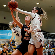 Fresno Pacific forward Bayli McClard (40) has a shot blocked Azusa Pacific guard Savanna Hanson (4) and Azusa Pacific forward Cierra Roufosse (20) during the second quarter of the PacWest basketball championships semifinals in the Felix Event Center at Azusa Pacific University Friday, Mar. 6, 202, in Azusa. (Mandatory Credit: Chris M Leung-Sports Shooter Academy)