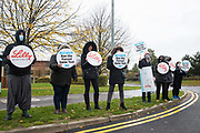 PETA supporters, including one wearing a costume depicting a beaker of water in which a mouse is struggling to stay afloat, protest outside Eli Lilly's R&D centre to call on the US pharmaceutical company to ban the forced swim test on 29 October 2020 in Bracknell, United Kingdom. Animal rights charity PETA UK contends that the forced swim test during which small animals are dosed with an anti-depressant drug, placed in inescapable beakers filled with water and forced to swim to keep from drowning has been widely discredited and that other pharmaceutical companies including Johnson & Johnson, GlaxoSmithKline, Pfizer, Bayer, Roche and AstraZeneca have banned it.