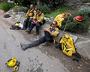 Firefighters rest during  brushfire, Sunday, Sept. 3, 2017, in Burbank, Calif. Several hundred firefighters worked to contain a blaze that chewed through brush-covered mountains, prompting evacuation orders for homes in Los Angeles, Burbank and Glendale.(Photo by Ringo Chiu)<br /> <br /> Usage Notes: This content is intended for editorial use only. For other uses, additional clearances may be required.