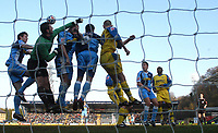 Photo: Alan Crowhurst.<br />Wycombe Wanderers v Torquay United. Coca Cola League 2. 18/03/2006. Wycombe players jumps with Torquay keeper Andy Marriott.