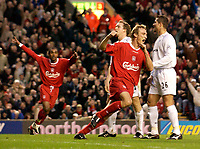 Photo. Jed Wee.<br /> Liverpool v Bolton Wanderers, FA Barclaycard Premiership, Anfield, Liverpool. 26/12/2003.<br /> Liverpool's Sami Hyypia celebrates as Bolton players look disappointed and Florent Sinama-Pongolle (L) joins in to celebrate.