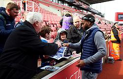 Tottenham Hotspur's Danny Rose signs autographs for fans before the Premier League match at the bet365 Stadium, Stoke.