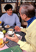 Active Aging Senior Citizens, Retired, Activities, Aged Couples Dine, Breakfast at Home, Special Times, Loving Conversation