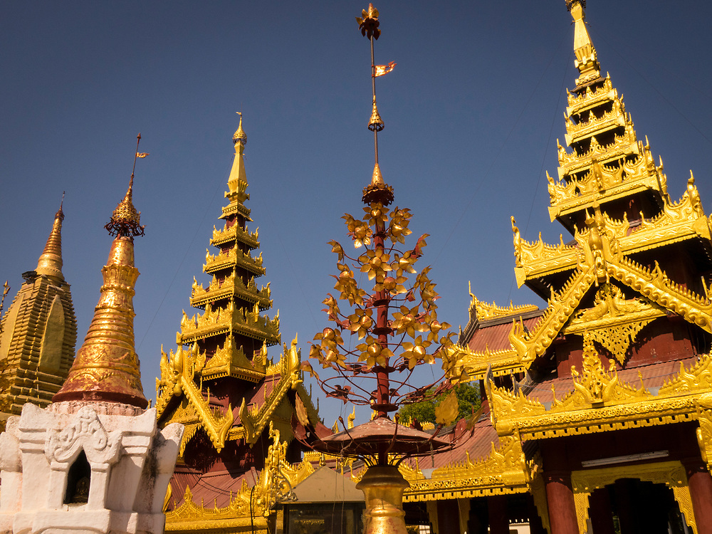 Spires at the Shwe Zigon Zedi. The Shwezigon Pagoda is one of the oldest and most impressive monuments of Bagan