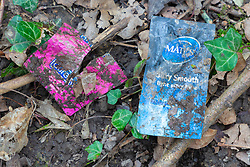 Condom and lubricants sachets are to be found in the area surrounding a dogging spot - a place where people meet to have sex with strangers, just off the A26 at Eridge near Tonbridge Wells in Kent. March 27 2019.