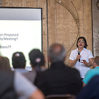 Petra Sanchez, Remedial Project Manager from EPA fields questions about the clean up of the Jackpile-Paguate Uranium Mine during a public meeting held in Laguna Wednesday.