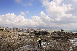 "Lebanese Kurds gather in celebration of Nayrouz on the rocks off the Mediterranean Sea, Beirut, Lebanon, March, 26, 2006. Nayrouz, ""New Day,"" is the traditional Kurdish celebration of spring."
