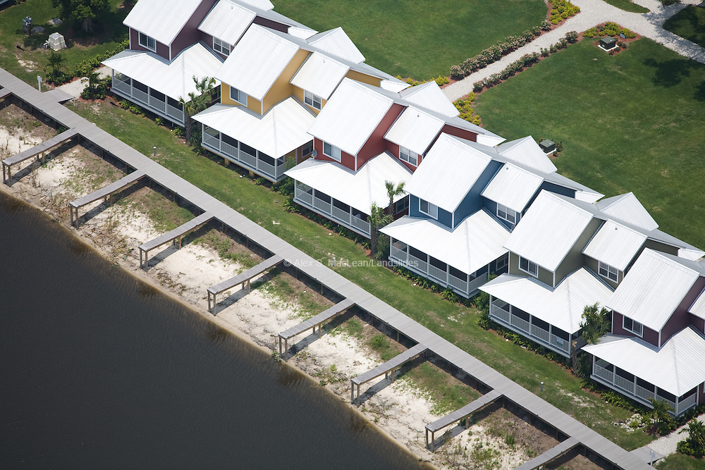 Owing to drought, the private docks of these new homes are no longer usable.  As a side effect of water-level recession, the town of Okeechobee has also lost out on fishing tourism.  In 2007, 1.9 million cubic yards of arsenic-laden mud was removed from the lake floor to reveal a more natural, sandy bottom, which should improve water clarity and habitability for plant and animal species.