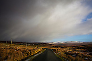 Snow clouds loom over the R230 from Glencolumkille to Ardara Road in Donegal, Ireland, January 2015. Copyright Dave Walsh