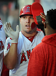 May 3, 2018 - Anaheim, CA, U.S. - ANAHEIM, CA - MAY 03: Los Angeles Angels of Anaheim center fielder Mike Triout (27)in the dugout after scoring on an Angels hit in the first inning of a game against the Baltimore Orioles played on May 3, 2018 at Angel Stadium of Anaheim in Anaheim, CA. (Photo by John Cordes/Icon Sportswire) (Credit Image: © John Cordes/Icon SMI via ZUMA Press)