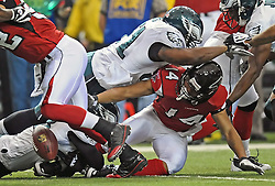 ATLANTA - DECEMBER 6: Wide receiver Eric Weems #14 of the Atlanta Falcons fumbles the ball during the game against the Atlanta Falcons on December 6, 2009 at Georgia Dome in Atlanta, Georgia. The Eagles won 34-7.(Photo by Drew Hallowell/Getty Images)  *** Local Caption *** Eric Weems